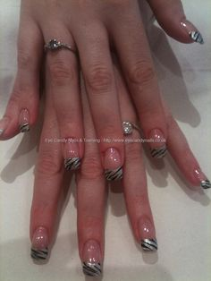Silver and black animal print nail art