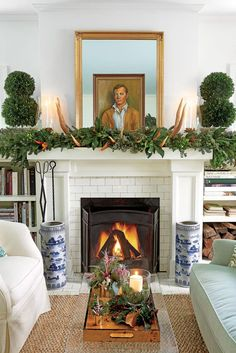 "The Living Room | The Hillenmeyers lean on fresh greenery and keep colorful frills to a minimum in their 1926 Lexington Craftsman cottage. As cliché as it sounds, there's no simpler way to explain Shannon and Joseph Hillenmeyer's holiday-decor ethos than ""bringing the outside in."" Joseph says, ""There are so many fresh greens and berries with great textures and scents available to decorate with during this time of year."" Of course, this duo knows just the right greenery to use."