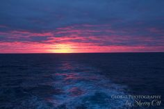 Sunset on the longest day in the southern hemisphere.  A soft pink glow remained all night while cruising through Antarctica around December 21st.
