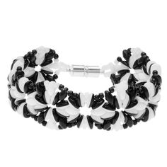This black and white bead woven design features SuperDuo Duets and SuperDuos working together to make this modern angular bracelet.