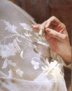 Lucette Nurdin-Vigneron embroidering white on white satin ~ one of the few remaining master embroiderers in France in this esteemed and dying art.   She won a coveted distinction as Meilleur Ouvrier de France in 1989.