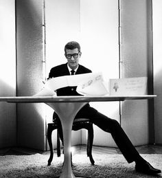 Yves Saint Laurent working in his studio, 1964. Photo by Robert Doisneau.