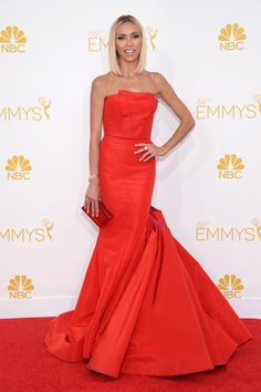 Giuliana Rancic: Grade B-  Though her scarlet strapless Gustavo Cadile dress with a dramatic train fit her like a glove, Rancic's limp hairstyle was a tad underwhelming.
