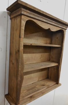 Hello and thank you for stopping by. Here is an adorable sweetheart that was a customer request to have it stained walnut and distressed. I think it turned out like a shelf that would have been in a saloon. It can be hung on the wall or set on a table. This shelf measures approximately 21 inches tall by about 20 inches wide and about 5 1/2 inches deep. I added two D-rings on the back for easy hanging. I hope you enjoy looking at it as much as I enjoy making it. Feel free to email with ...