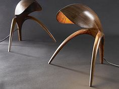 Walnut sculpted lamps by Gildas Berthelot création de meuble... they look like itty bitty little creatures. hilarious.