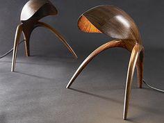 Walnut sculpted lamps by Gildas Berthelot création de meuble... they look like itty bitty little creatures. hilarious.