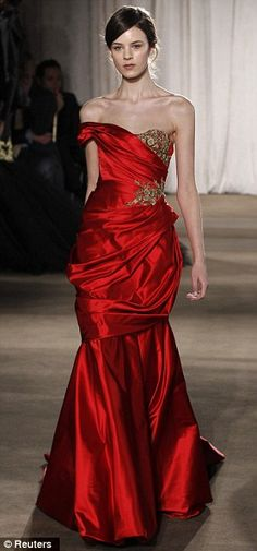 Jewel tones: Rich hued gowns were adorned with antiqued gold leaf embroidery, and suede corsets and dresses added an unexpected flair