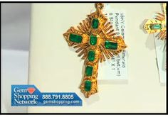 Lovely emerald and 18K yellow gold cross perfect for a Christmas gift