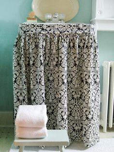 How to Hide a Sink Pedestal with a Fabric Skirt --> http://www.hgtv.com/design/rooms/bathrooms/how-to-make-a-sink-skirt?soc=pinterest