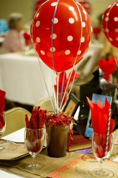 centerpiece idea! pink balloon, maybe a can with map glued around it, and put some flowers in can??