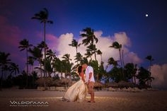 Artistic Beach Afterglow / Post wedding photo session, Majestic Elegance, Punta Cana, Dominican Republic, cool light, newlyweds, couple, early morning, moon, clouds, palm trees, tropical, destination wedding, kissing, holding hands, exotic