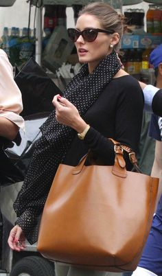 i want a polka dot scarf ! <3 her classic essentials = gold watch & camel purse