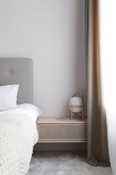 Love this muted colour palette in the bedroom, with lighting by Santa & Cole.