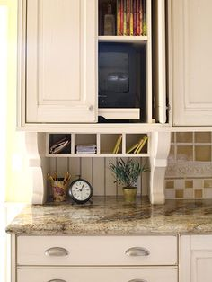 Mess-Free Message Center              Having a home office or message center in the kitchen can be extremely helpful. However, without sufficient storage, the area can easily be overtaken by clutter. Here a deep upper cabinet conceals a television and keeps books, documents, and office supplies organized and off the counter. A four-cubby desk organizer mounted beneath the upper cabinet functions as a mini mailbox for each family member