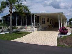 Nice mobile home sun porch and brick landscaping via MHVillage.com