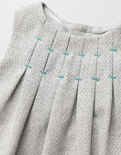 pleats stitched in contrasting threads