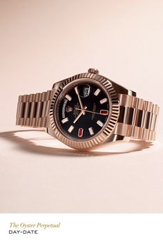 Rolex Day-Date II in Everose gold with a black dial set with diamonds and rubies. #RolexOfficial