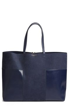 Free shipping and returns on Tory Burch 'Block-T - Large' Tote at Nordstrom.com. Raw yet refined, this minimal tote crafted from bonded leather is perfect for both everyday use and weekend travel. A spacious interior easily accommodates your tech and other essentials, while a removable zip pouch is ideal for organizing your keys and smartphone. A polished toggle closure and contrast interior lend modern touches to this ever-versatile style.