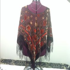 """💰REDUCED💰STUNNING! Not Your Average Poncho! Offering a HandMade """"Poncho/Shawl!"""" It did have a tag that said """"HandSewn In Japan,"""" which my textile person told me it is """"pre-war era"""" it's a great & versatile piece. So very pretty! The palate is plum/browns/creams & an orange-red that creates a floral motif. It's 40""""L at the points with an additional 6""""L of fringe! Enjoy & Posh-On! Handmade in Japan Jackets & Coats Capes"""