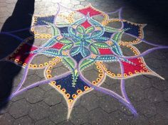 """Using just colored sand, artist Joe Mangrum beautifies streets and museum floors in major US cities. What's most amazing is that this artist comes up with his highly detailed, often symmetrical pieces without any advance planning. Instead, every design is improvised by """"the inspiration that comes from the day."""""""