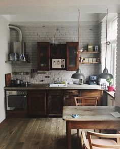 lovely mix of wood tones - concrete counters - brick wall - rustic - industrial - eclectic - kitchen