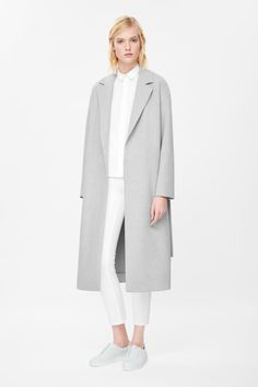 Made from lightly padded fabric with a melange quality, this open-front coat is an elongated style with a tie fastening belt. Unlined, it has wide notched lapels, in-seam pockets and a single vent on the back. Minimalist Fashion Women, Minimal Fashion, Minimal Chic, Fashion Over 40, Look Fashion, Belted Coat, Womens Fashion For Work, Mode Style, Coats For Women