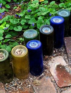 These bottles make a pretty garden edge. I like the bits of pea gravel in the indentations. It's also a good place to collect pretty little stones.