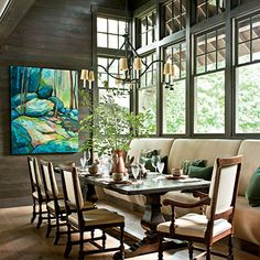 A banquette offers maximum seating and visually links the furniture and architecture.     Source Guide  Wall wash: Urbane Bronze (SW7048), cut 50% with water; sherwin-williams.com.  Chandelier: Gothic Chandelier (DL-CD06); dennisandleen.com.  Dining table: Trestle Table in Dark Oak; tablesofdistincti....  Dining chairs: a...