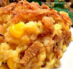 "Bacon, Butter, Cheese & Garlic: Corn Casserole:: We really thought this was great!! I didn't change anything, but someone commented that they put some cooked bacon, sautéed onion and smoked Gouda with the cheddar. I will try that next time.. It's a "" keeper"""