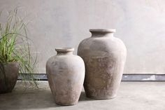 These authentic clay pots are handmade from clay with a raw natural finish. We love the aged look of these pieces. The pots are made using traditional coiling techniques in Vietnam. Hanging Planters, Planter Pots, Vases, Glass Terrarium, Antique Metal, Terracotta Pots, Handmade Home, Clay Pots, Garden Tools