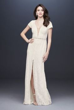 A plunging neckline, finished with an illusion mesh panel, creates the sleek bodice of this lace, cap-sleeve sheath wedding gown. By Galina, exclusively at David\'s Bridal Polyester Sweep train Ba Galina Wedding Dress, Sheath Wedding Gown, Wedding Dress Sleeves, Long Wedding Dresses, Long Sleeve Wedding, Wedding Dress Styles, Dresses With Sleeves, Lace Wedding, 2nd Marriage Wedding Dress
