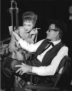 Milburn Stone and Amanda Blake looking at a picture on the set of Gunsmoke