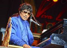 Little Richard headlined Viva Las Vegas Rockabilly Weekend at The Orleans on Saturday, March 30, 2013. Little Richard talked about breaking his hip a few years ago. Because of his age (80), doctors said that he can't survive an operation, so he no longer walks. He told the crowd how lucky he is to still be alive and able to sing. He performed for about an hour, played all his hits and after each song talked to the crowd about his life and band members.