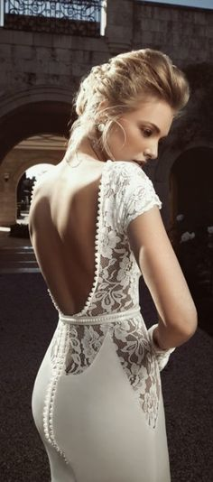 Gorgeous backless floral detail lace wedding dress love the buttons