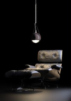 Here's one of those matches that seem made in heaven: the Eames Lounge Chair and the Wrecking Ball Lamp.