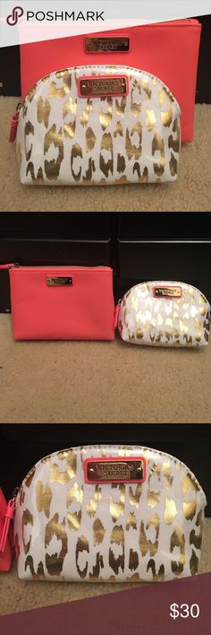 NWOT Victoria's Secret Makeup Bags NWOT Victoria's Secret Makeup Bags. Medium size is coral, brand new (7inches across). Mini leopard bag, white and gold brand new (6inches across). 💕 Victoria's Secret Bags Cosmetic Bags & Cases