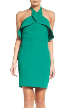 This jewel toned ruffle sheath cocktail dress is the perfect statement piece for any occasion