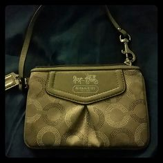 Coach wristlet NWOT Cute wristlet with embroidered C logo and silver embossed horse and carriage logo with leather detailing. Perfect as a cell phone clutch. Never been used. Coach Bags Clutches & Wristlets