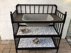 old changing table and vintage sink re purposed into a dry sink/bar area for patio