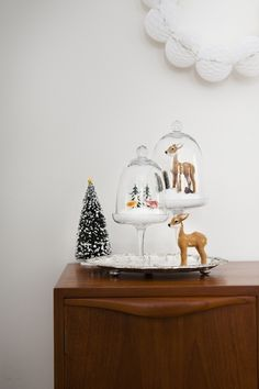 Festive vignettes in cake stands closest we will come in Australia to a white Christmas, love those furry realistic deer!