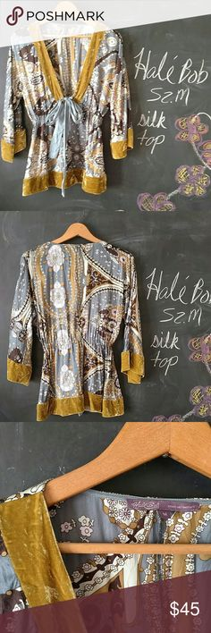 Hale Bob Boho Silk Top Sz M Velour Trim Sequins Hale Bob Silk Top Sz M. Bohemian style shirt with sequin details and velour trim. Tie tightens or loosens shirt.  Gorgeous top.   Length of top is 25 in from shoulder to hem.   Bust is generous because of sleeve style and open front.  Up to 38 in bust.  Sleeves are flowy 3/4 in  Great Preowned condition.  May a a few loose sequins.  Overall great condition. No stains or holes.  No trades. Hale Bob Tops