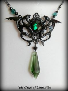 The Basilisk - Harry Potter Slytherin inspired green crystal snake dragon necklace.