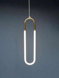 Canadian designer Lukas Peet has created the Hanging Light, using an energy efficient fluorescent bulb. A Pendant light that literally hangs from its electrical cord. The light is available in either pale textured yellow or 24 karat gold leaf. Bar Interior, Interior Lighting, Home Lighting, Lighting Design, Pendant Lighting, Kitchen Lighting, Light Pendant, Pendant Lamps, Luxury Lighting