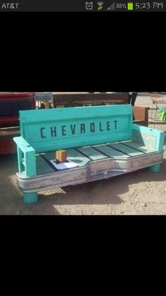 Cool Chevrolet bench~ and it's turquoise!  My husband would insist on a Ford, though.