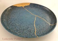 celadon kintsugi pottery mended with gold effect