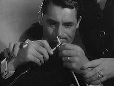 "Cary Grant ""knitting"" in Mr Lucky (1943).  So funny!"