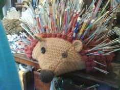 Cute hedgehog pin cushion for knitting needles.