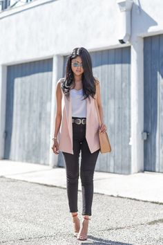 Pale pink vest + high waisted jeans