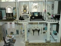 Yes... this is a BARBIE DOLL HOUSE!  Can you say OH MY LANTA!!!! Look at that detail!  Those Barbies have nicer living quarters than I do!