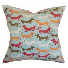 """Cotton pillow with dachshund motif. Made in the USA. Product: PillowConstruction Material: Cotton cover and 95/5 down fillColor: CarnivalFeatures:  Insert includedHidden zipper closureMade in the USA Dimensions: 18"""" x 18""""Cleaning and Care: Spot clean only"""